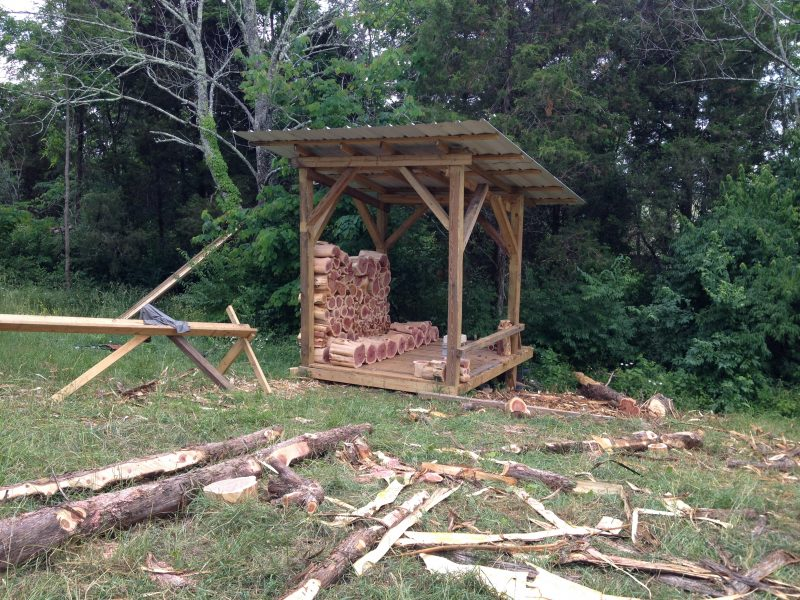 We dried the cedar logs for our cordwood house in an open sided shed. This was a cheap and easy solution for getting our logs dried to a low moisture content. #cordwood