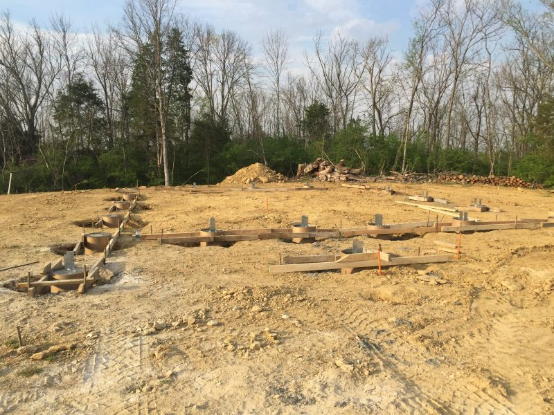 Concrete piers finished and waiting for slab prep on our off grid cordwood home