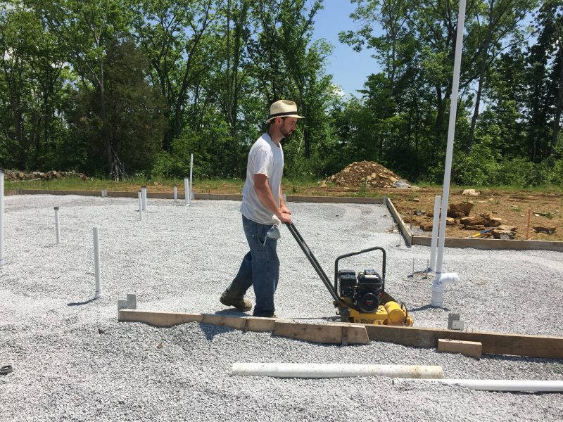 Compacting gravel to prep for our concrete slab