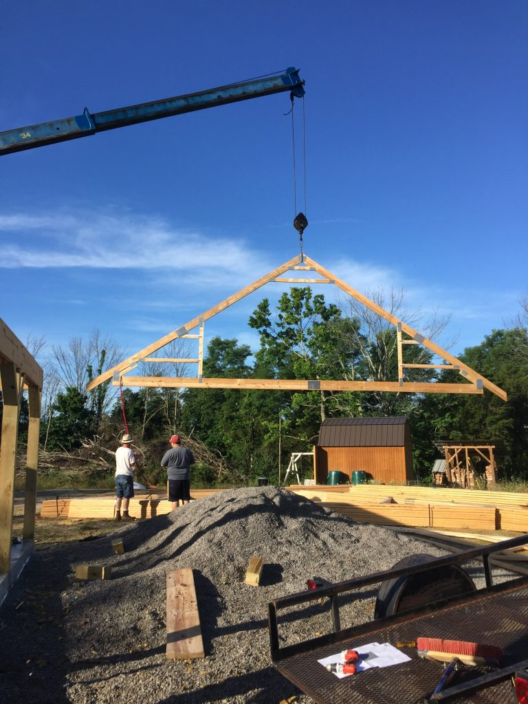 Hanging trusses is a dangerous job that requires attention to safety.