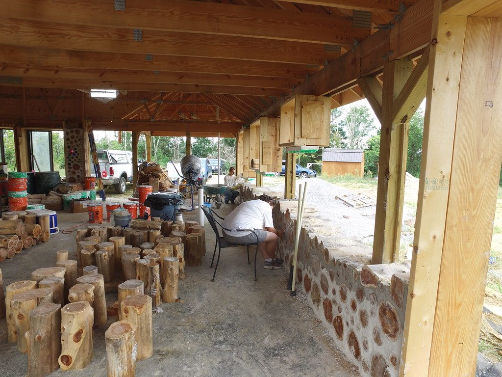 Working together on a cordwood wall - accidentalhippies.com