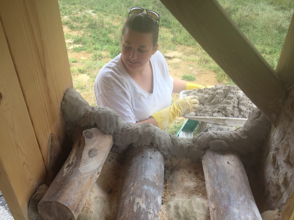 Building a cordwood wall - check out their progress updates!