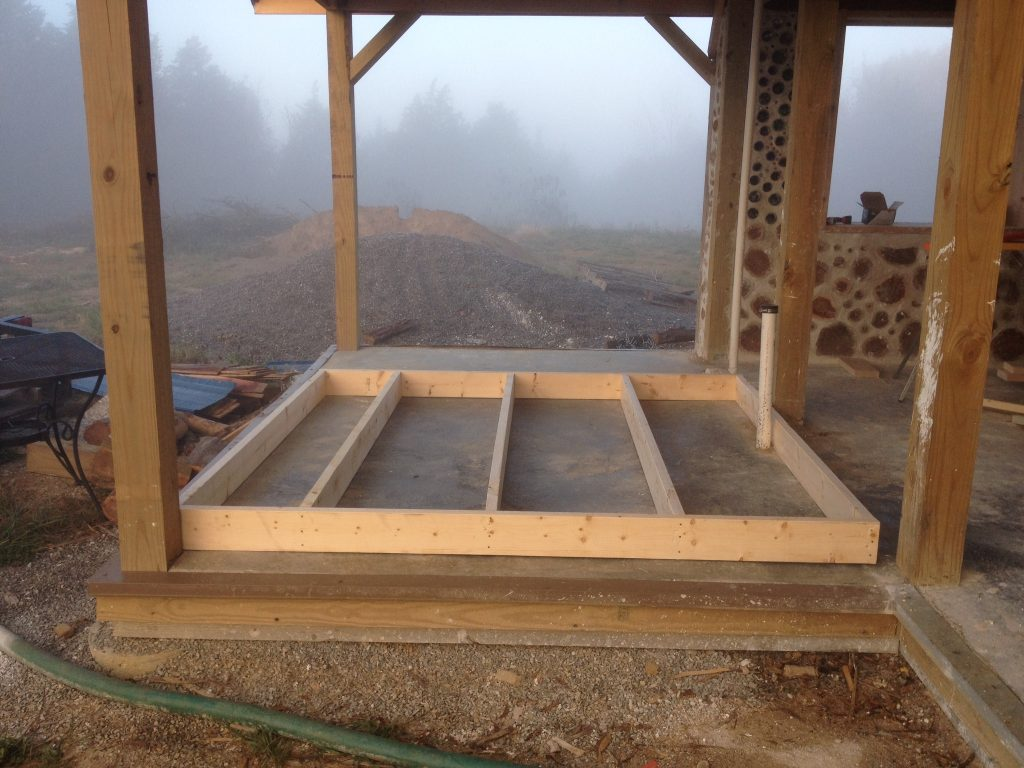 Stud framed wall built on the floor before being raised into position