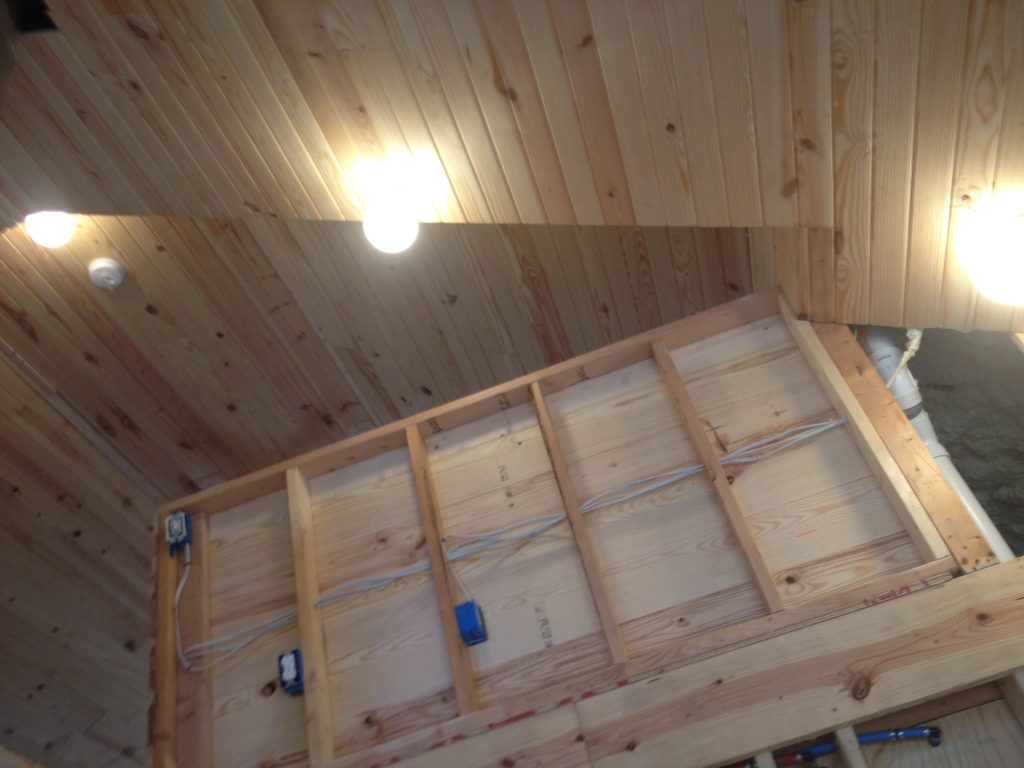 Tongue and groove pine planking with our newly installed and functional lights in our off-grid house. Solar power will be providing all of the energy to run these and much more. Learn more!