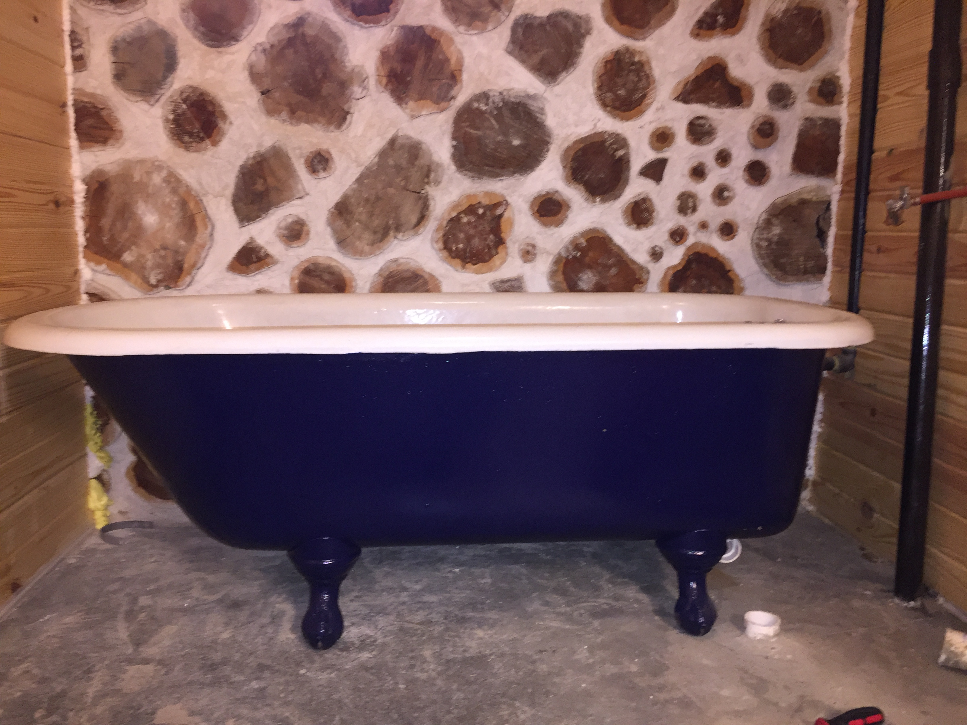 We took this old clawfoot tub and redid it ourselves for less than...