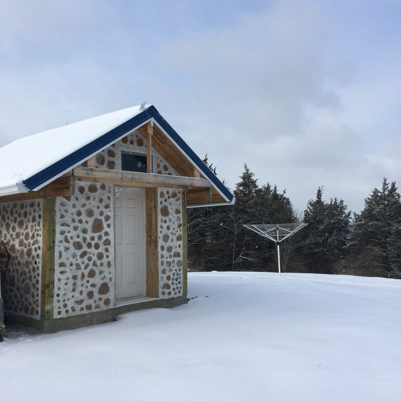 cordwood shed in the snow