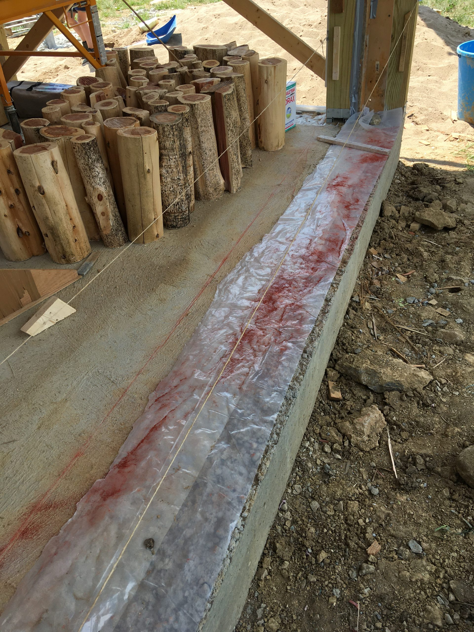 Chalk line used to keep cordwood wall straight